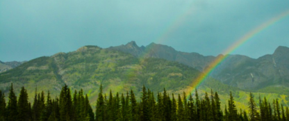 rainbow and mountains in banff alberta canada